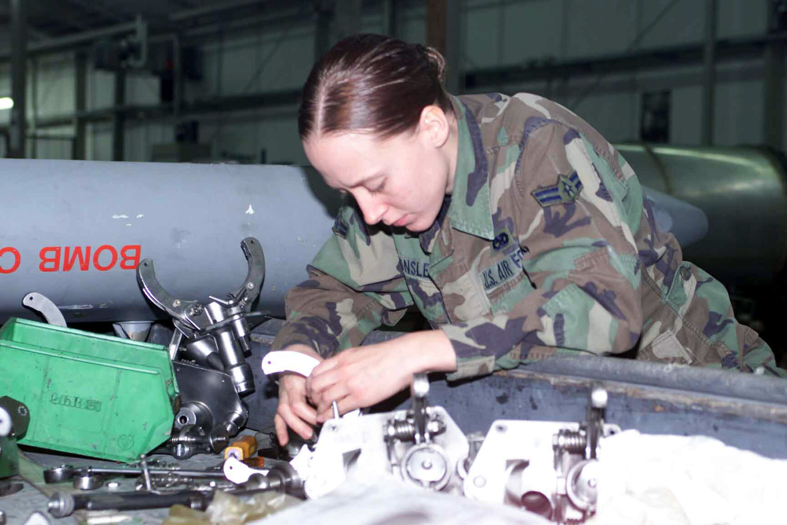 US Air Force (USAF) AIRMAN First Class (A1C) Katie Sponsler, an Aircraft Armament Systems Apprentice, with the 52nd Equipment Maintenance Squadron (EMS), at Spangdahlem Air Base (AB), Germany, disassembles, cleans and reassembles an F-16 bomb dispenser unit during a periodic 180 day inspection