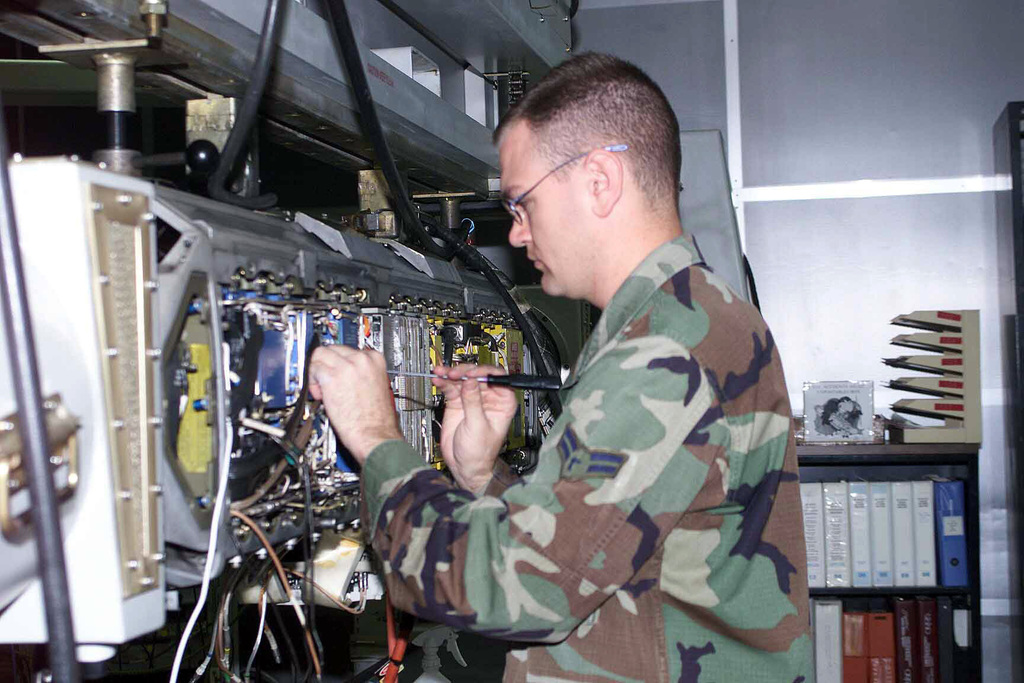 US Air Force (USAF) AIRMAN First Class (A1C) Nicholas Morrison, an Electronic Warfare Apprentice, with the 52nd Component Maintenance Squadron (MS), at Spangdahlem Air Base (AB), Germany, installs a radio frequency jamming section an ALQ\131 Electronic Countermeasures (ECM) Pod
