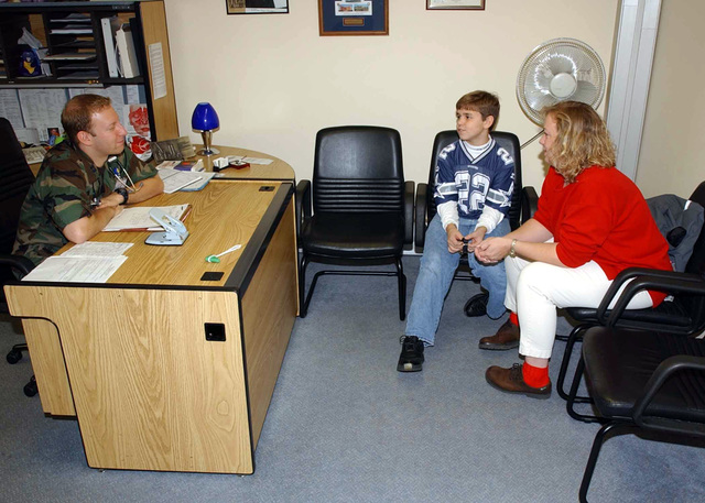 US Air Force (USAF) Captain (CAPT) Joel M. Shulkin, a Pediatrician, converses regularly with patient Ethan Grubbs and his mother Stacy Grubbs, at Spangdahlem Air Base (AB), Germany