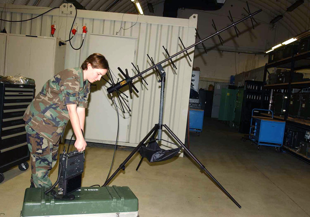 US Air Force (USAF) SENIOR AIRMAN (SRA) Nicola M. Hines, with the 606th Air Control Squadron (ACS), assembles a tactical satellite antenna at Spangdahlem Air Base (AB), Germany