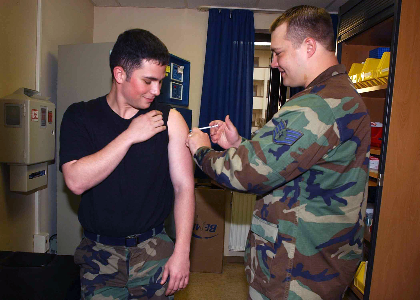 US Air Force (USAF) STAFF Sergeant (SSGT) Anthony L. Duranti, with the 52nd Medical Operations Squadron (MOS), injects SENIOR AIRMAN (SRA) Christopher P. Medaugh with an Influenza shot at the immunizations clinic at Spangdahlem Air Base (AB), Germany