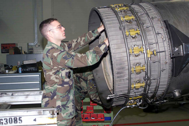 US Air Force (USAF) STAFF Sergeant (SSGT) Keith Zeigler, Aerospace Propulsion technician, with the 52nd Component Maintenance Squadron (MS), at Spangdahlem Air Base (AB), Germany, removes the exhaust nozzle on an F110-GE-129 jet engine during a periodic inspection