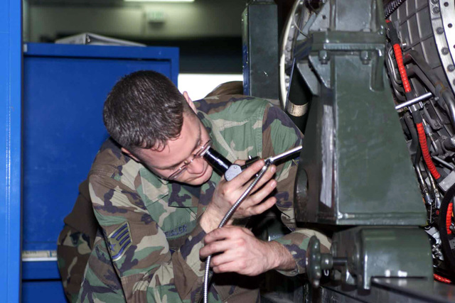 US Air Force (USAF) STAFF Sergeant (SSGT) Keith Zeigler, an Aerospace Propulsion technician, with the 52nd Component Maintenance Squadron (MS), at Spangdahlem Air Base (AB), Germany, gets an inside look at the turbine of a jet engine using a Borescope