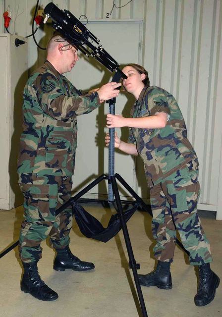 US Air Force (USAF) STAFF Sergeant (SSGT) Matthew A. Byrd and USAF SENIOR AIRMAN (SRA) Nicola M. Hines, with the 606th Air Control Squadron (ACS), assemble a tactical satellite antenna at Spangdahlem Air Base (AB), Germany