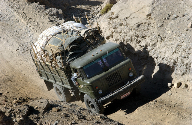 A GAZ-66 (4X4) 2,000 kg truck is used to transport humanitarian aid materials through the steep and narrow roads leading to the village of Nejhab, located in the mountains of Afghanistan. The aid, donated by US Army (USA) Soldier assigned to the 489th Civil Affairs Battalion, and from the 8th and 9th Psychological Operations Groups, include 10 medium size tents, 250 blankets, and three medical kits, and is headed for the villagers before the colder seasons begin
