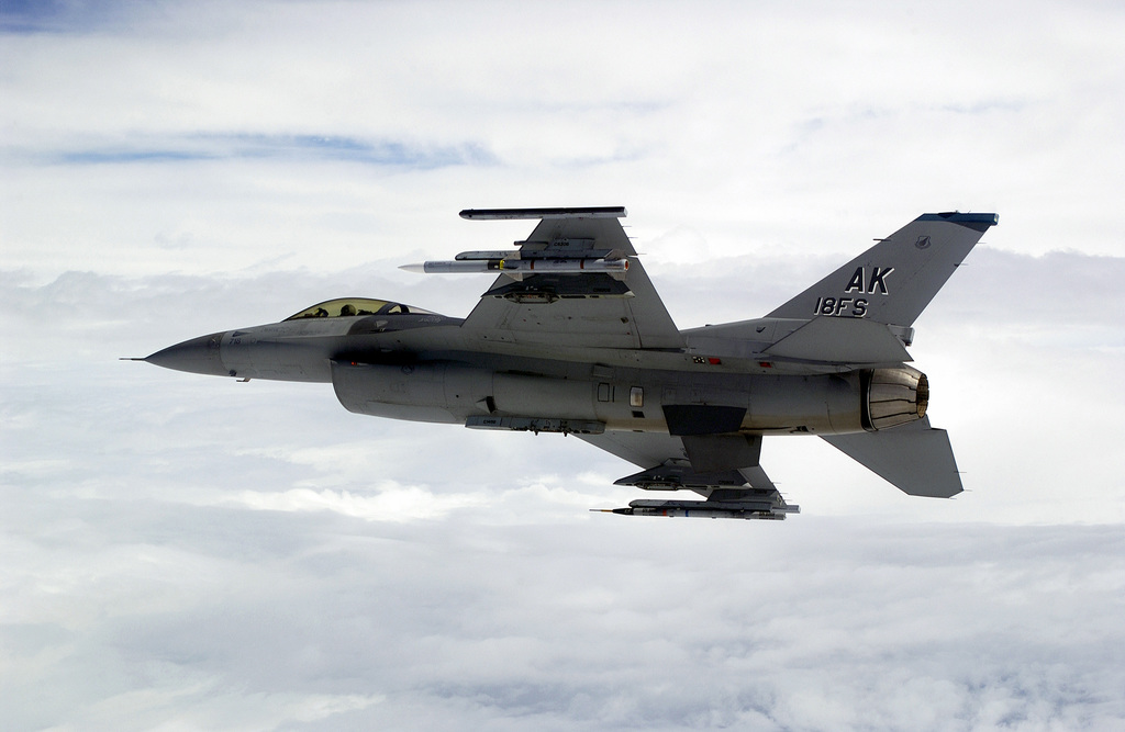 A US Air Force (USAF) F-16C Fighting Falcon aircraft from the 18th Fighter Squadron (FS), 354th Fighter Wing (FW) Eielson Air Force Base (AFB), Alaska, flies over the Gulf of Mexico during exercise Combat Archer, a Weapons System Evaluation Program (WSEP) hosted by the 83rd Fighter Weapons Squadron located at Tyndall, AFB, Florida (FL). The aircraft is equipped with an airborne instrumentation pods, and armed with an AIM-120B Advanced Medium Range Air-to-Air Missiles (AMRAAM)