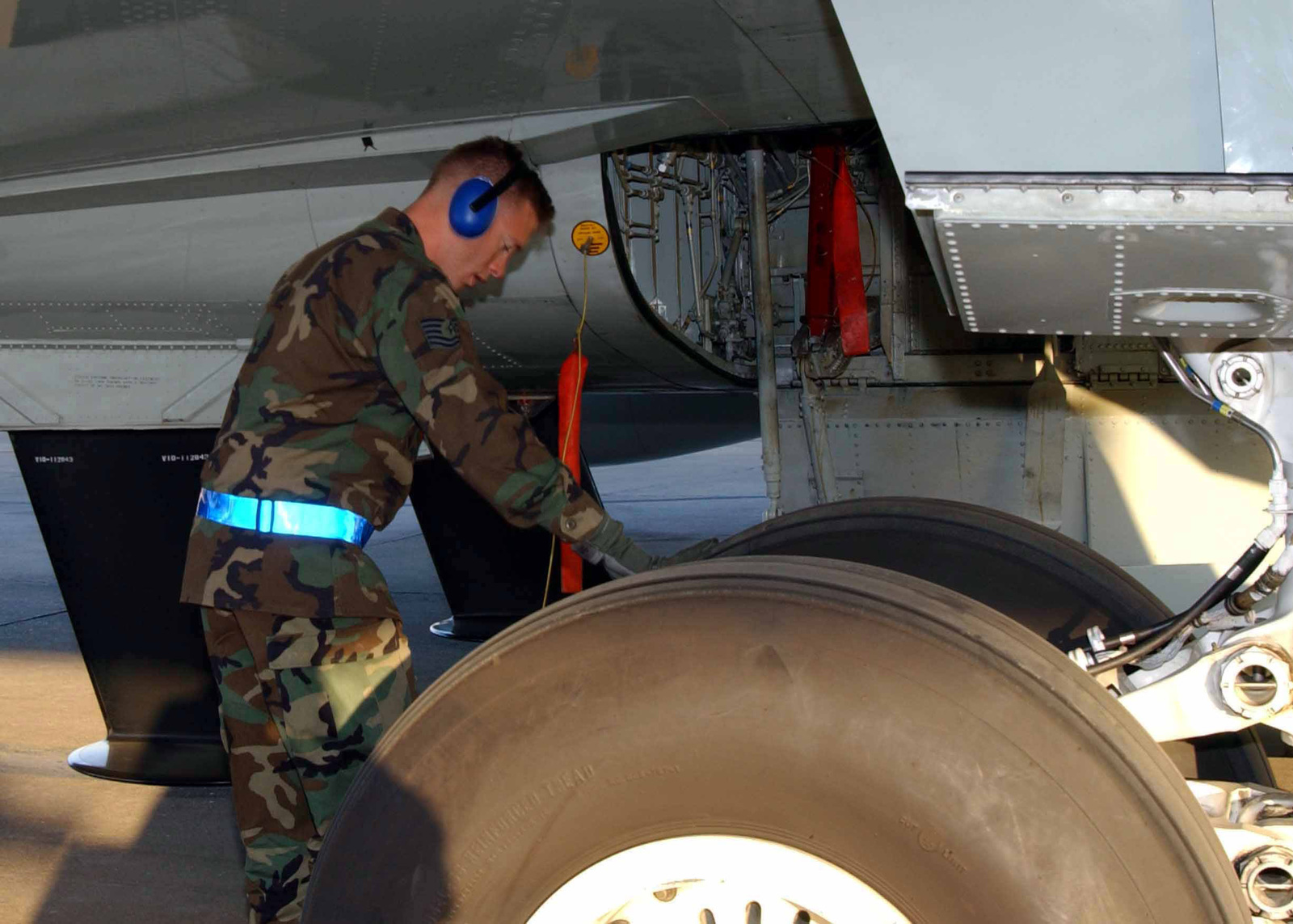 US Air Force (USAF) Technical Sergeant (TSGT) Dan Young, Hydraulic Systems Technician, 922nd Expeditionary Reconnaissance Squadron (ERS), performs preflight checks on the landing gear hydraulic system of an USAF RC-135 Rivet Joint aircraft prior to conducting a mission from Incirlik Air Base (AB), Turkey, during Combined Task Force, Operation NORTHERN WATCH