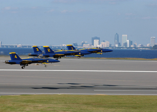 The US Navy (USN) Blue Angels Flight Demonstration team takes flight during the Sea and Sky Spectacular 2002 Annual Air Show and Open House held aboard Naval Air Station (NAS) Jacksonville, Florida (FL), to put on a show of mixed formation flying and solo routines by the F/A-18 Hornet multi-mission fighter/attack aircraft