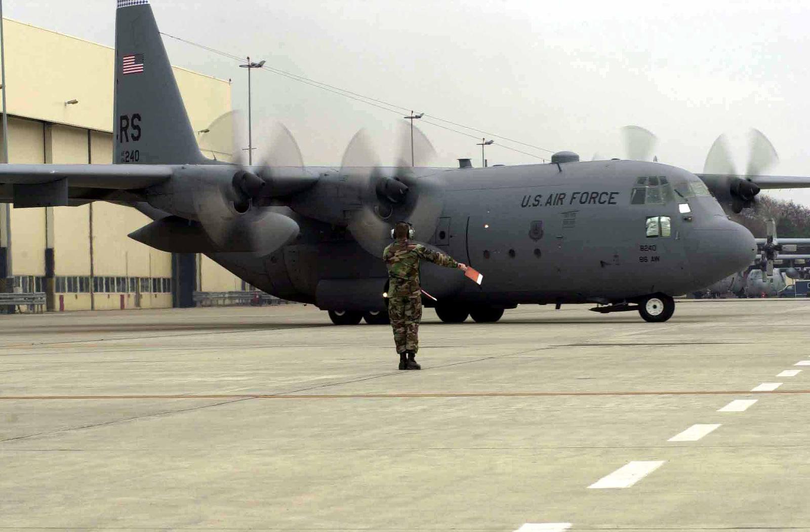 US Air Force (USAF) SENIOR AIRMAN (SRA) Jordan King, 86th Maintenance Squadron, 86th Airlift Wing, marshals a USAF C-130 Hercules aircraft onto the runway at Ramstein Air Base (AB), Germany