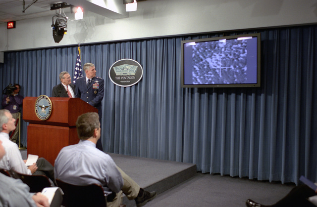 U.S. Air Force GEN. Richard B. Myers (right), Chairman of the Joint Chiefs of STAFF, and the Honorable Donald H. Rumsfeld (left), U.S. Secretary of Defense, shows a video footage during a press briefing at the Pentagon, Washington, D.C., on Nov. 4, 2002.  OSD Package No. A07D-00687 (DOD PHOTO by Helene C. Stikkel) (Released)