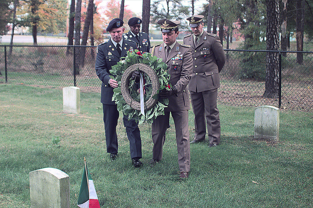 Colonel (COL) John W. Ives (left), USA, Installation Commander, and Lieutenant Colonel (LCOL) Claudio Totteri, (Italian Army), Assistant Military Attach of the Embassy of Italy, prepare to lay a wreath during the Italian Wreath Laying Ceremony, in memory of WWII Italian Prisoners of War (POW) interred at the Fort Meade Cemetery. In the background are Command Sergeant Major (CSM) Earl L. Ware (left), USA, and Warrant Officer Manuel Saetti, Italian Embassy
