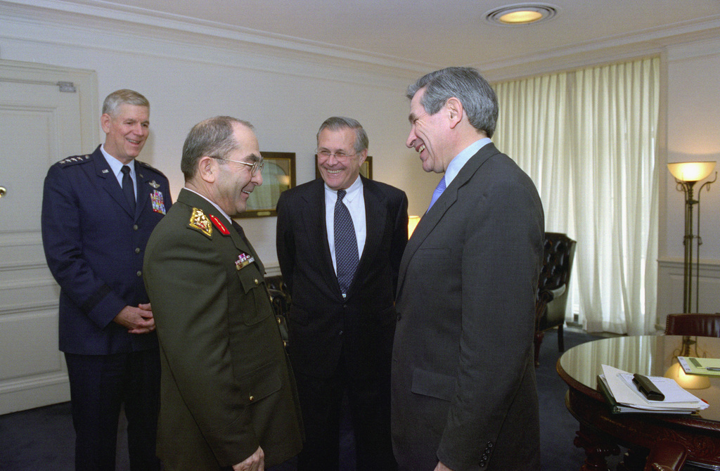 GEN. Hilmi Ozkok (center), Commander-in-CHIEF of the Armed Forces of Turkey, shares a laugh with (from right-to-left), the Honorable Paul Wolfowitz, U.S. Deputy Secretary of Defense, the Honorable Donald H. Rumsfeld, U.S. Secretary of Defense, and U.S. Air Force GEN. Richard B. Myers, Chairman of the Joint Chiefs of STAFF, during his visit at the Pentagon, Washington, D.C., on Nov. 5, 2002.  OSD Package No. A07D-00688 (DOD PHOTO by Helene C. Stikkel) (Released)