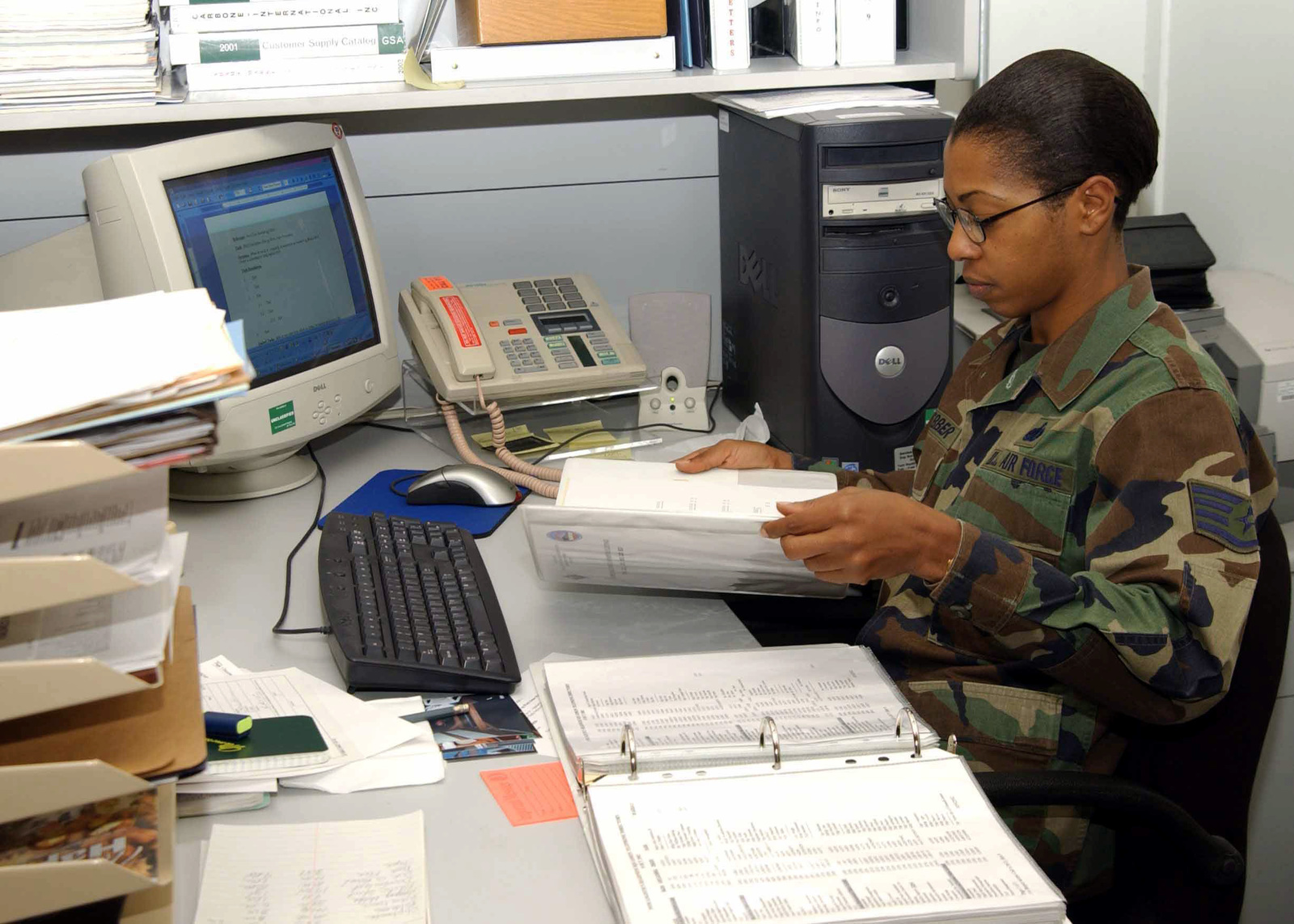 US Air Force (USAF) STAFF Sergeant (SSGT) Lanette Webber, Non-Commissioned Officer in Charge (NCOIC) of supply for the logistics directorate, researches her supply accounts inside her office, while deployed at Incirlik Air Base (AB), Turkey, in support of Combined Task Force (CTF), Operation NORTHERN WATCH