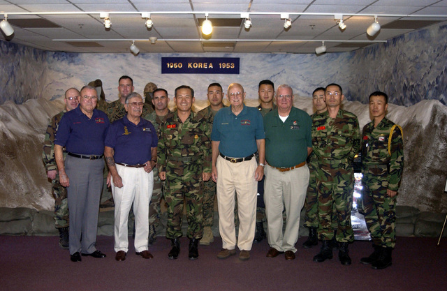 Lieutenant General (LTGEN) Lee C. Woo, Republic of Korea Marine Corps Commandant (third from left) and his staff pose for a group photo with veterans of the Korean war and Marine Escorts during his visit to the Marine Corps Recruit Depot (MCRD) San Diego, California