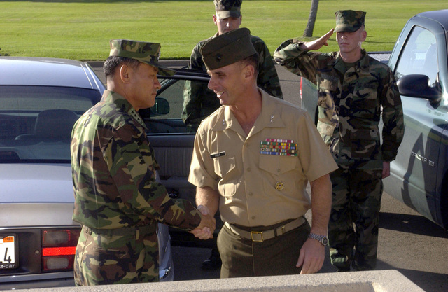 Lieutenant General (LTGEN) Lee C. Woo, Republic of Korea Marine Corps Commandant, shakes hands with Major General (MGEN) Jan Huly, Commanding General (CG) of the Marine Corps Recruit Depot (MCRD) San Diego, Western Recruiting Region, at the conclusion of his visit