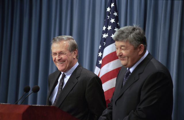 The Honorable Donald H. Rumsfeld (left), U.S. Secretary of Defense, attends a press briefing with Army General-Colonel Mukhtar Altytnbaev, Kazakhstan Minister of Defense, at the Pentagon, Washington, D.C., on Nov. 14, 2002.  OSD Package No. A07D-00703 (DoD photo by Helene C. Stikkel) (Released)