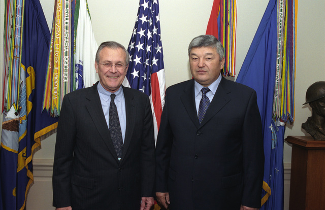 The Honorable Donald H. Rumsfeld (left), U.S. Secretary of Defense, poses for a picture with Army General-Colonel Mukhtar Altytnbaev, Kazakhstan Minister of Defense, at the Pentagon, Washington, D.C., on Nov. 14, 2002.  OSD Package No. A07D-00703 (DoD photo by Helene C. Stikkel) (Released)