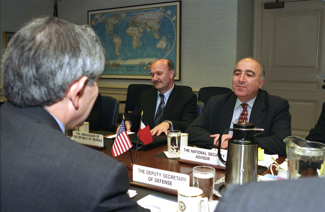 The Honorable Paul D. Wolfowitz (foreground), U.S. Deputy Secretary of Defense, attends a meeting with Tedo Jataridze (right), National Security Advisor for the Republic of Georgia, at the Pentagon, Washington, D.C., on Nov. 14, 2002.  OSD Package No. A07D-00702 (DoD photo by Robert D. Ward) (Released)
