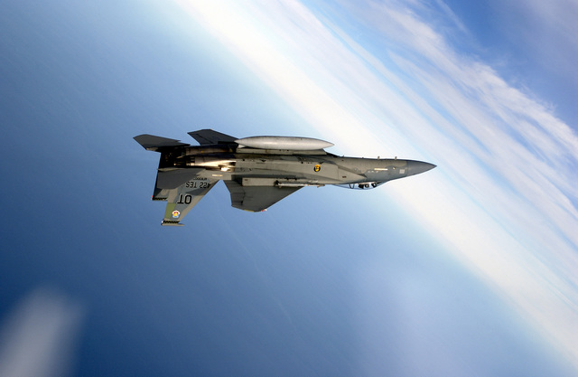 A US Air Force (USAF) F-15C Eagle aircraft assigned to Detachment 1, 28th Test Squadron located at Nellis Air Force Base, Nevada, maneuvers into a inverted dive during a mission to evaluate the AIM-9X Sidewinder short-range, heat-seeking air intercept missile, conducted by the Air Force Operational Test and Evaluation Center, Detachment 2, at Eglin AFB, Florida (FL)
