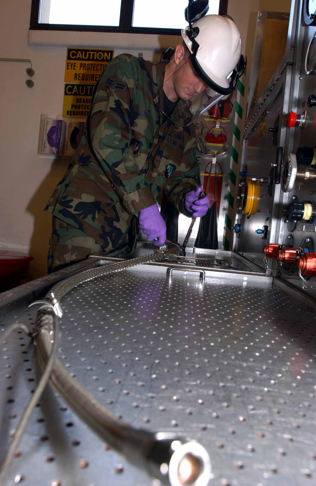 US Air Force (USAF) AIRMAN First Class (A1C) Adam Hooke, Hydraulic Journeyman, Accessories flight, 31st Maintenance Squadron (MXS), sets up the AvTec 843 Hydraulic Test Stand. This operation checks hydraulic equipment on the F-16 Fighting Falcon to include; Brakes, shocks, flight controls - such as leading edge slats. The test stand insures the equipment generates and handles the proper hydraulic pressure