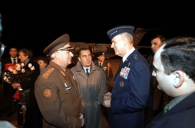 US Air Force (USAF) General (GEN) Richard B. Myers (right), Chairman of the Joint Chiefs of STAFF (CJCS), is met upon his arrival in Tbilisi, Republic of Georgia, by General Lieutenant Joni Pirtskhalaishvili, CHIEF of the General STAFF for the Republic of Georgia. GEN Myers is meeting with top military officials and the Georgian President to discuss the Georgia Train and Equip Program (GTEP). GTEP is a flexible, time phased training initiative that builds upon a strong military-to-military relationship developed between the US and the Republic of Georgia since the end of the Cold War, and further underscores US support for the Republic of Georgia's sovereignty, independence and...