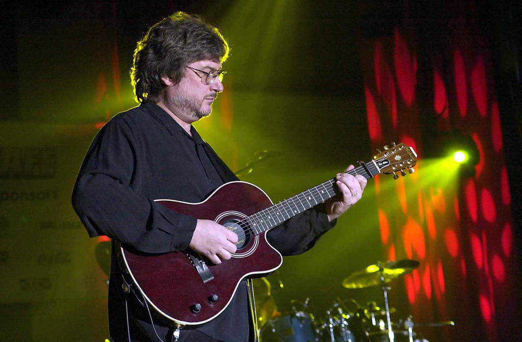 Greg Jennings, guitarist for the country band, Restless Heart, entertains the local military community at RAF Mildenhall, United Kingdom, during the Operations Season's Greetings concert held at RAF Mildenhall, United Kingdom