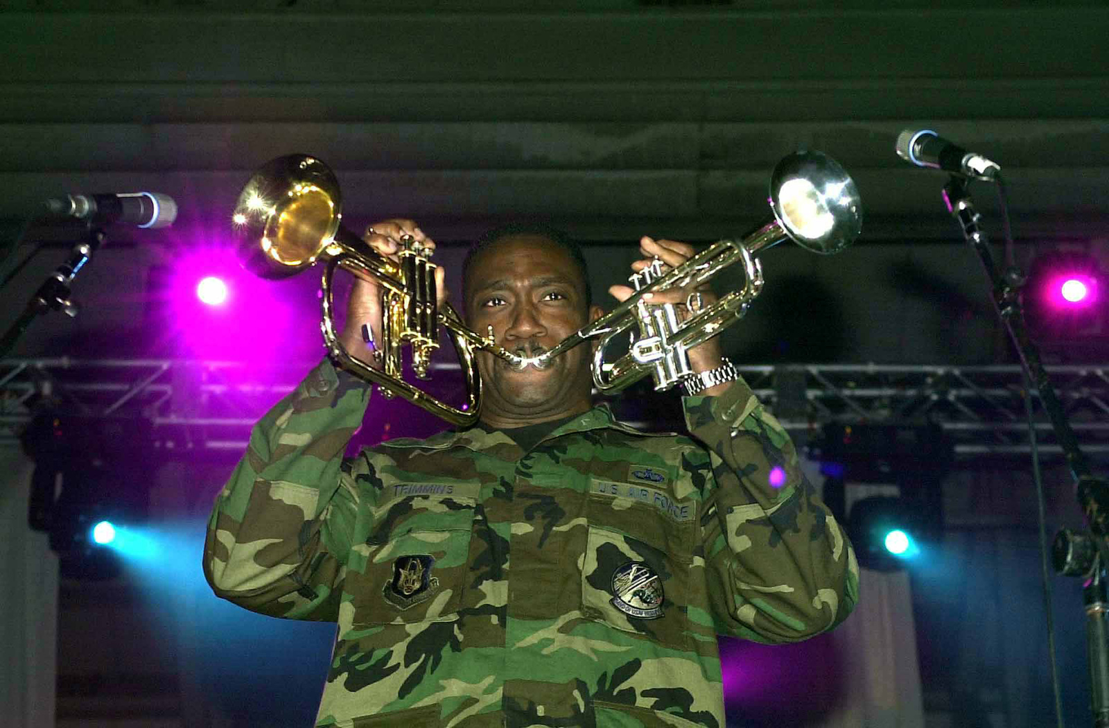 US Air Force (USAF) Technical Sergeant (TSGT) Kenneth Trimmins, Air Force Reserve Command Band, plays two horns at the same time during the Operations Season's Greetings concert held at RAF Mildenhall, United Kingdom