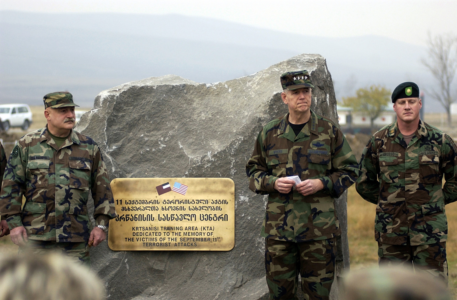 US Air Force (USAF) General (GEN) Richard B. Myers (center), Chairman of the Joint Chiefs of STAFF (JCS), and General Lieutenant David Tevzadze, Republic of Georgia Minister of Defense, speak at a dedication ceremony. A memorial dedication ceremony held to honor all of the victims of the September 11th terrorist attack in New York and the Pentagon is conducted outside of the Advanced Operational Base for the Georgia Train and Equip Program in Krtsanisi, Georgia. General Myers is touring the Georgia Train and Equip Program (GTEP) complex and training grounds along with meeting top military officials and the Georgian President to discuss GTEP. GTEP is a flexible, time phased training...