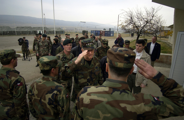 US Air Force (USAF) General (GEN) Richard B. Myers, Chairman of the Joint Chiefs of STAFF (JCS), saluted by the Republic of Georgia, Georgian Commando Battalion's Primary STAFF during a tour of the Advanced Operational Base for the Georgia Train and Equip Program in Krtsanisi, Republic of Georgia. General Myers is touring the Georgia Train and Equip Program (GTEP) complex and training grounds along with meeting top military officials and the Georgian President to discuss GTEP. GTEP is a flexible, time phased training initiative that builds upon a strong military-to-military relationship developed between the US and the Republic of Georgia since the end of the Cold War, and further...