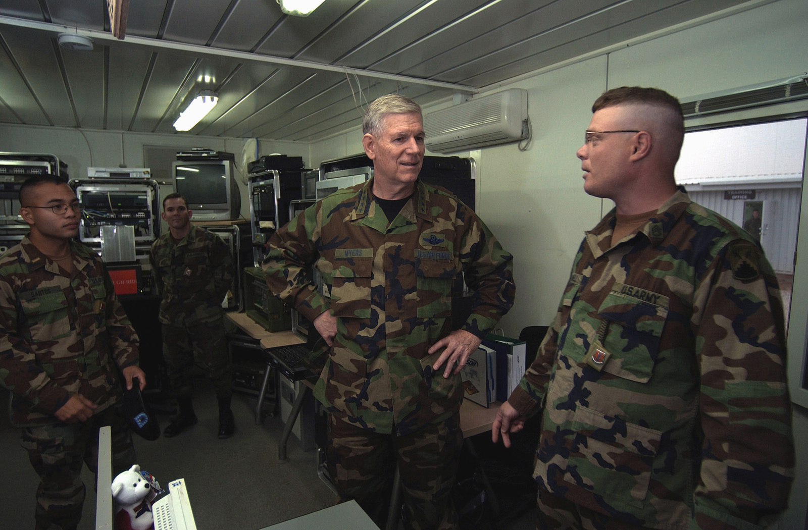 US Army (USA) STAFF Sergeant (SSG) Daniel Cornell (right), Non-Commissioned Officer in Charge (NCOIC), 7th Signal Brigade Communications Package, Mannheim, Germany, explains the basic installation of all communications at the Advanced Operational Base in Krtsanisi, Republic of Georgia, to US Air Force (USAF) General (GEN) Richard B. Myers, Chairman of the Joint Chiefs of STAFF (JCS). General Myers is touring the Georgia Train and Equip Program (GTEP) complex and training grounds along with meeting top military officials and the Georgian President to discuss GTEP. GTEP is a flexible, time phased training initiative that builds upon a strong military-to-military relationship developed...