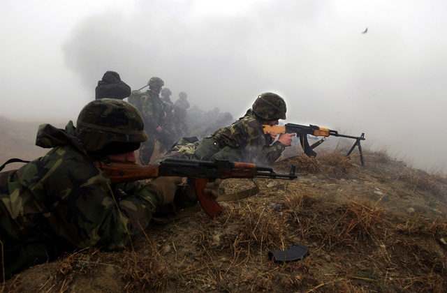 Republic Georgia (GEO) members 2nd Company, Georgian Commando Battalion fire their Kalashnikov AK-47 assault rifles at an objective during a live fire ambush exercise at a training range in Vasiani, Republic Georgia. The 10th Special Forces Group (Airborne) (in background) is in the Republic Georgia conducting the Georgia Train and Equip Program, which will enhance the Georgian soldiers abilities in various battlefield techniques. GTEP is a flexible, time phased training initiative that builds upon a strong military-to-military relationship developed between the US and the Republic Georgia since the end the Cold War, and further underscores US support for the Republic...