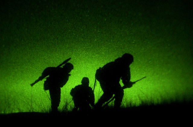 Night vision photo of Republic of Georgia members of the 2nd Company, Georgian Commando Battalion acting as a security team move into position during a night live fire raid exercise at a training range in Vasiani, Republic of Georgia. The US Army (USA) (Airborne) is in the Republic of Georgia conducting the Georgia Train and Equip Program, which will enhance the Georgian soldiers abilities in various battlefield techniques. GTEP is a flexible, time phased training initiative that builds upon a strong military-to-military relationship developed between the US and Georgia since the end of the Cold War, and further underscores US support for the Republic of Georgia's sovereignty,...
