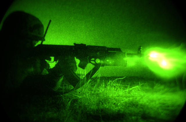 Night vision photo Republic Georgia (GEO) Lieutenant Besiki Lobzhanidza, 2nd Company, Georgian Commando Battalion firing his Kalashnikov AK-47 assault rifle at an objective during a night live fire raid exercise at a training range in Vasiani, Republic Georgia. The US Army (USA) (Airborne) is in the Republic Georgia conducting the Georgia Train and Equip Program, which will enhance the Georgian soldiers abilities in various battlefield techniques. GTEP is a flexible, time phased training initiative that builds upon a strong military-to-military relationship developed between the US and Georgia since the end the Cold War, and further underscores US support for the Republic...