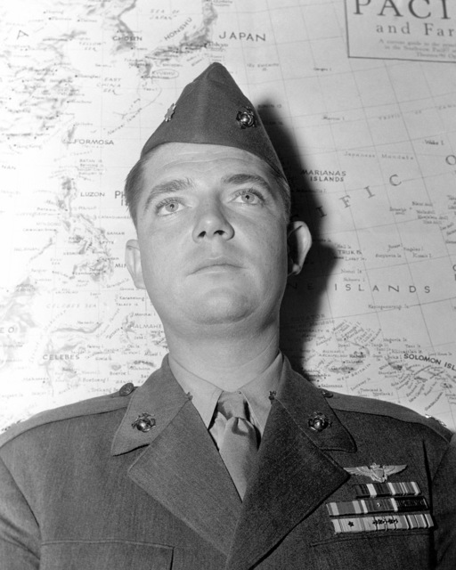 Official Portrait of US Marine Corps (USMC) Major Charles M. Kunz, taken at San Deigo, California (CA). MAJ Kunz has been awarded the Purple Heart and Navy Cross, he is holder of an Air Medal for participating in 56 strikes in the Marshall Islands and also has 2 Presidential Unit Citations and is an Ace Pilot credited with 8 kills