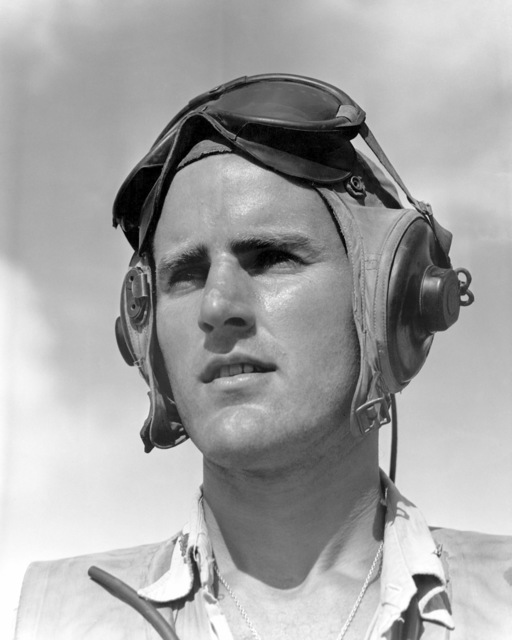 "World War II (WWII) area photograph of US Marine Corps (USMC) Major (MAJ), Jack E. Conger assigned to the Death Dealers"" squadron on Peleliu Island. MAJ Conger is an Ace Pilot credited with 10 kills. His home is 6009 North Waterbury Road, Des Moines, Iowa"