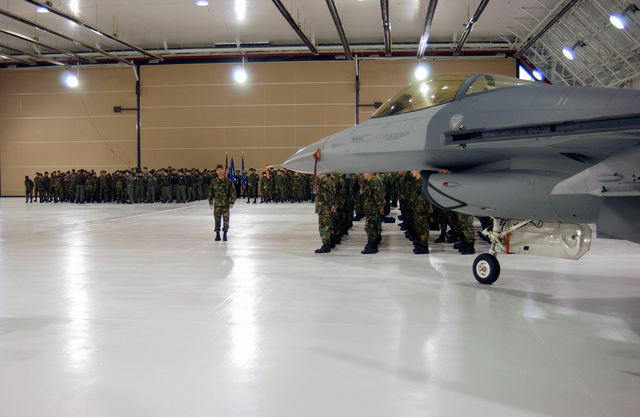 Over 1,000 US Air Force (USAF) members of the 174th Fighter Wing (FW), Syracuse, New York (NY), along with one of the wing's F-16C Fighting Falcons, formed up inside the hangar for the presentation of the Defense of Liberty Medal during this UTA (Unit Training Assembly). The Defense of Liberty Medal, presented only once, created by NY Governor George E. Pataki specifically for those who directly responded to the events of September 11, 2001