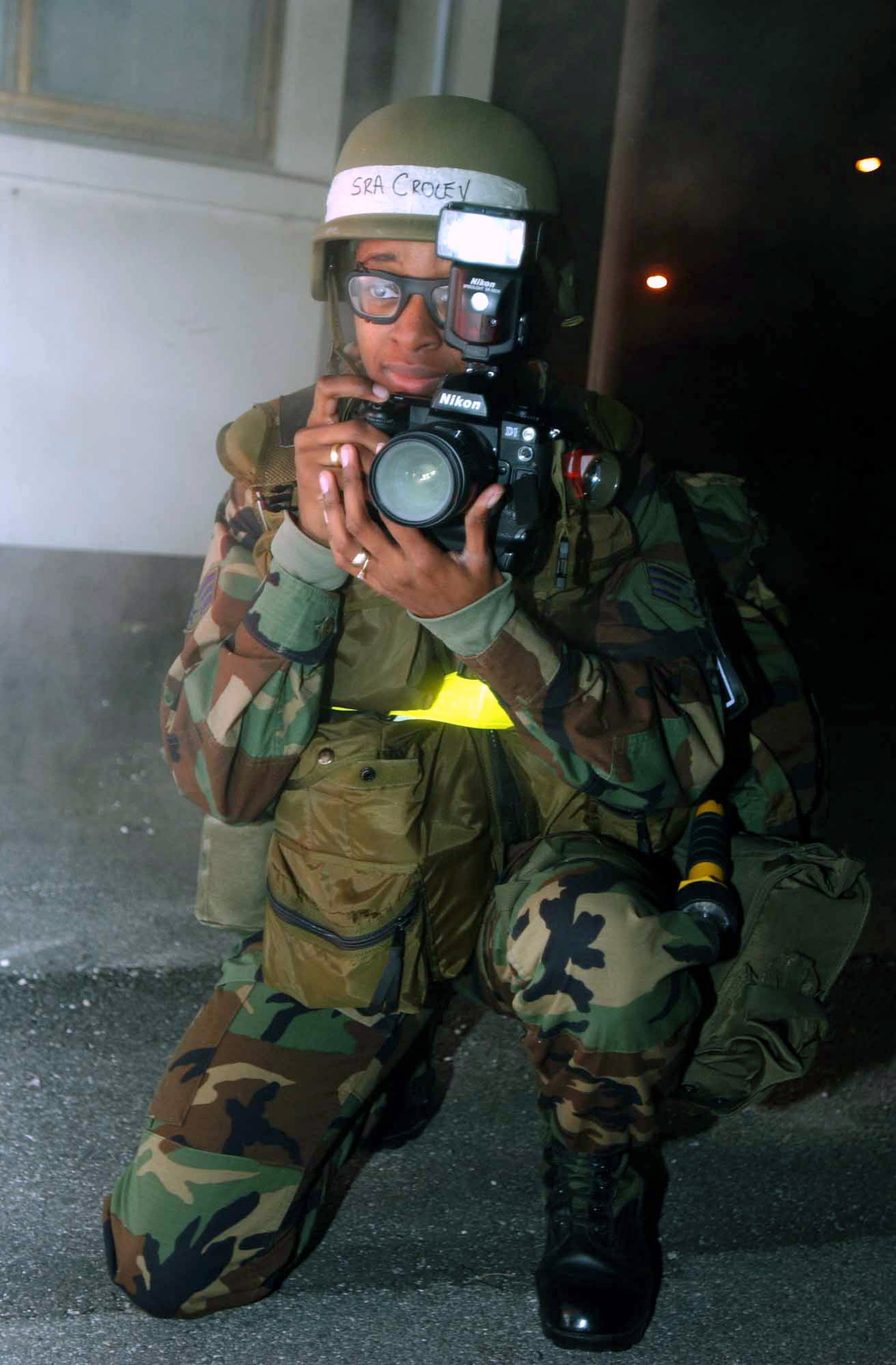US Air Force (USAF) SENIOR AIRMAN (SRA) Lakisha Croley, a Still Photographer, from the 31st Communications Squadron (CS), photographs the Base Recovery After Attack Team (BRAAT) members during a Local Salty Nation exercise