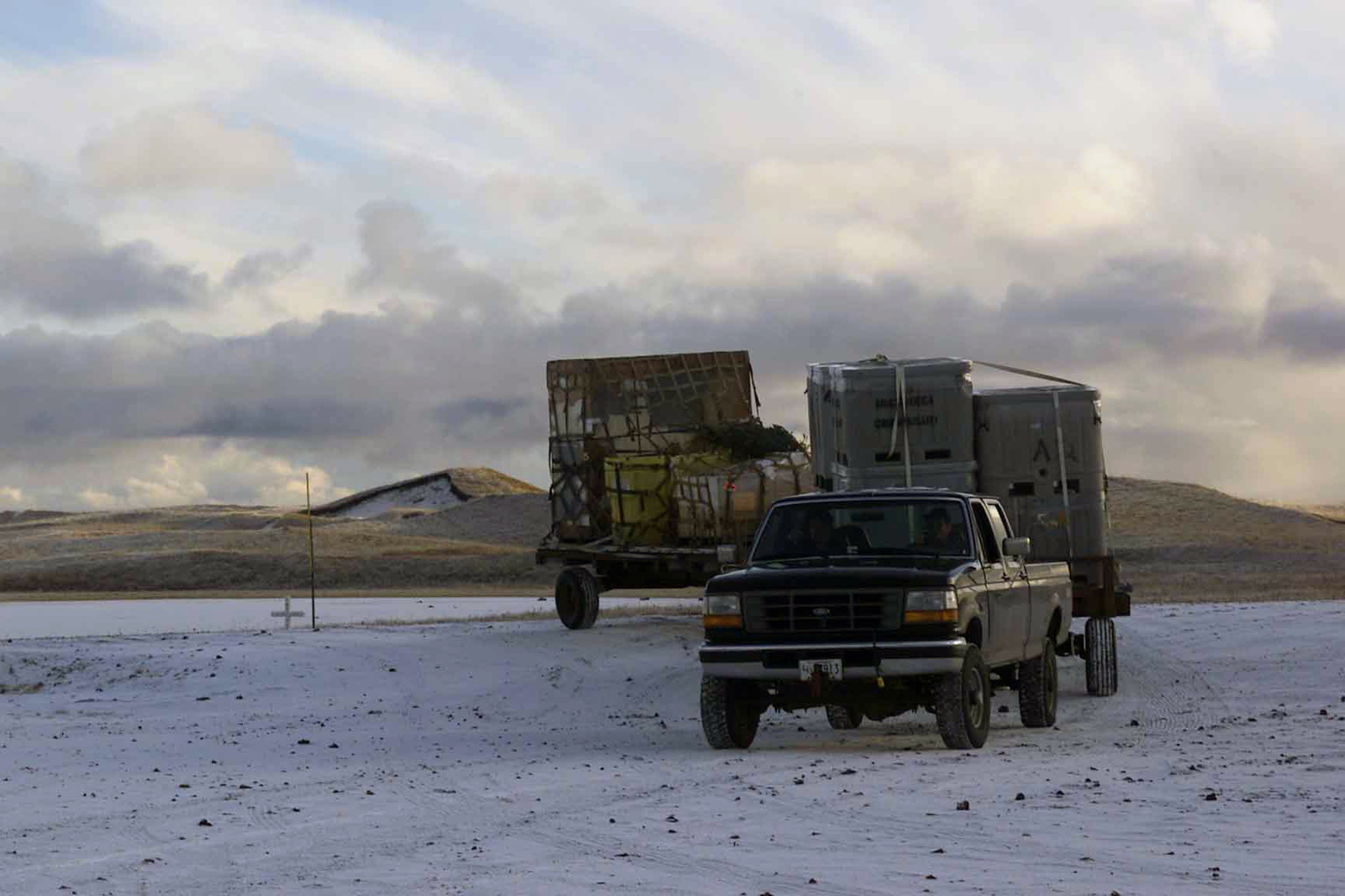 ... Of Assorted Cargo Airlifted From Kodiak Island To United States Coast  Guard (USCG) Base Loran C Station, St. Paul Island, Alaska, Are Towed To  Storage