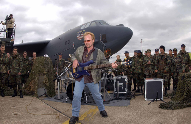 """Next to a US Air Force (USAF) B-52H Stratofortress bomber, lead singer Van McLain and his classic rock band Shooting Star, performs a free concert at Barksdale Air Force Base (AFB), Louisiana, in order to film a live performance of their music video, """"Let's Roll"""""""
