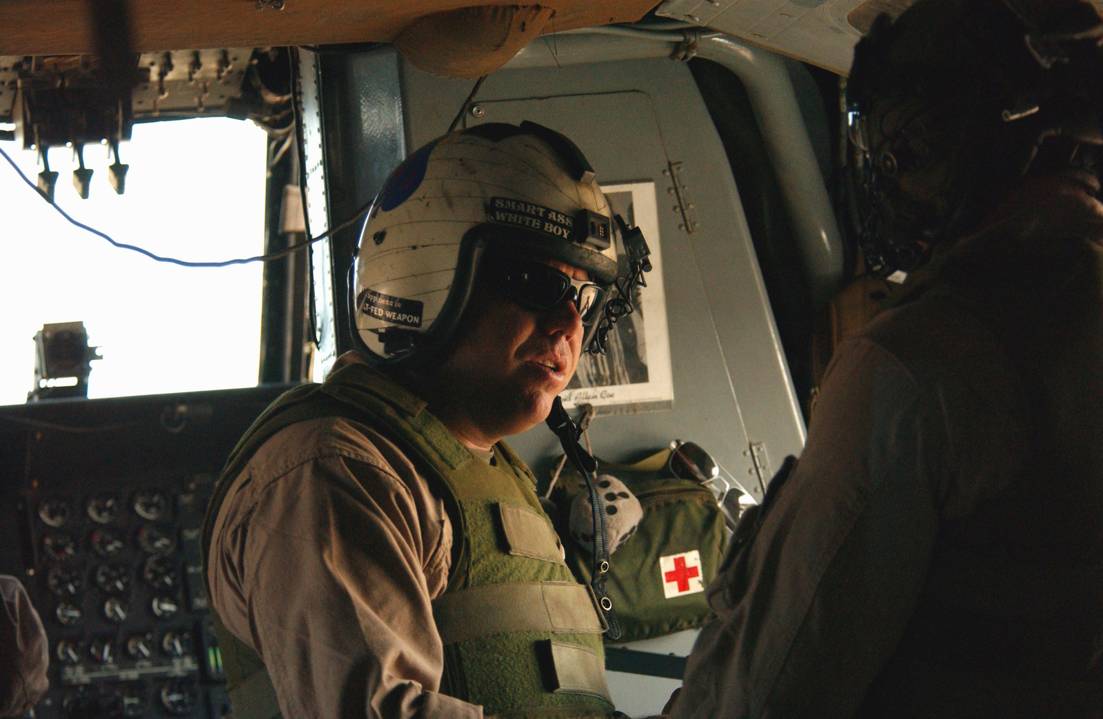 US Marine Corps (USMC) STAFF Sergeant (SSGT) Dennis Thurston, a Crew CHIEF from 24th Marine Expeditionary Unit, prepares for takeoff in an MH-53J Pave Low helicopter to practice Special Purpose Insertion and Extraction (SPIE) in support of Operation ENDURING FREEDOM