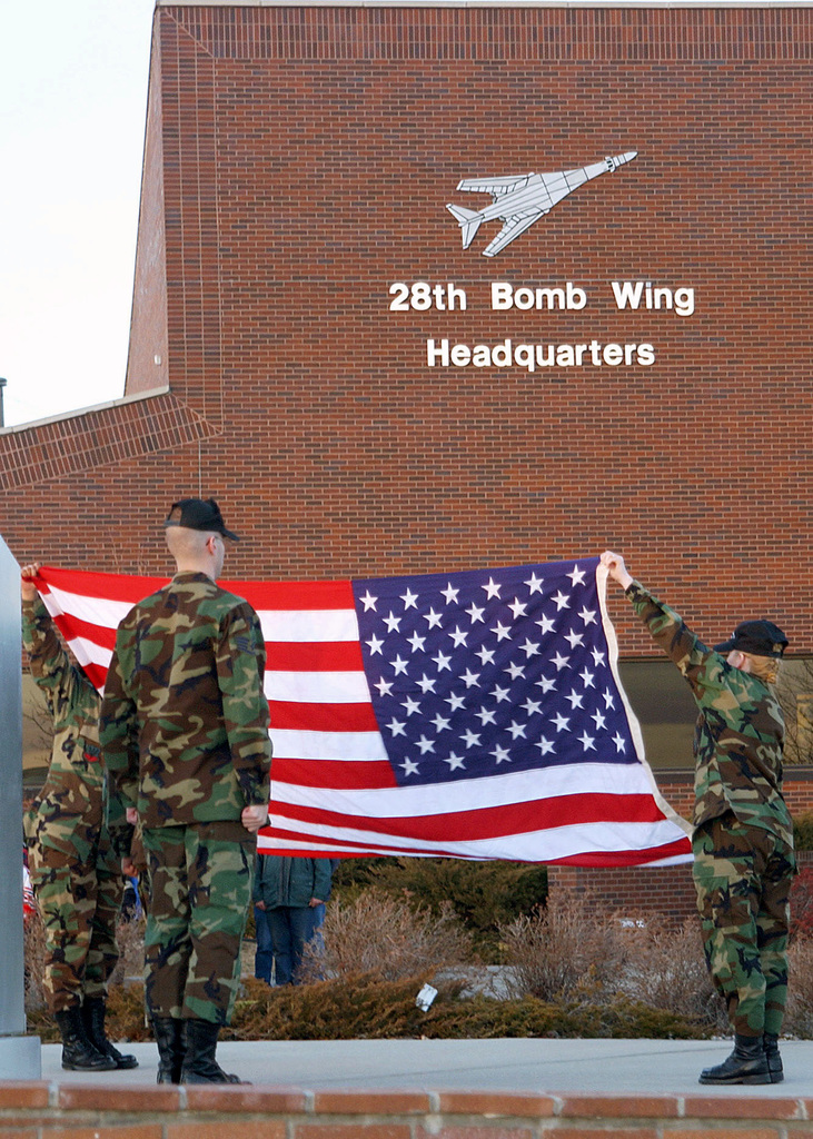 US Air Force (USAF) members of the 28th Bomb Wing (BW), Ellsworth Air Force Base (AFB), South Dakota (SD), base Honor Guard prepare to fold the flag following the newly formed 28th Mission Support Groups (MSG) first Retreat Ceremony