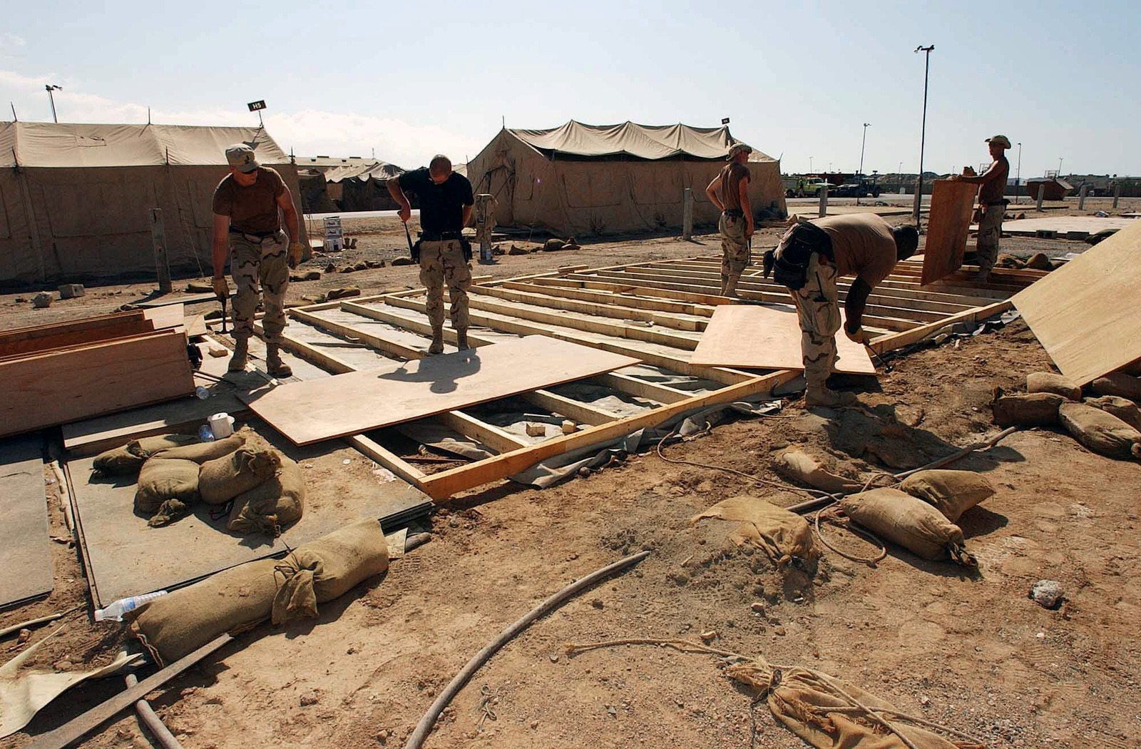 US Air Force (USAF) structural workers assigned to the 321st Expeditionary Civil Engineering Squadron (CES), breakdown a temper tent at a forward-deployed location in support of Operation ENDURING FREEDOM