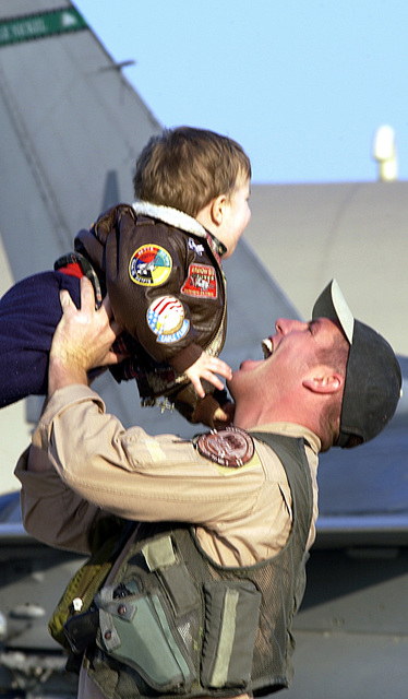 US Air Force (USAF) Captain (CAPT) Kevin Dydyk, Pilot, 31st Fighter Wing (FW), greets his son during a welcome home ceremony for troops returning from a three-month deployment from Kuwait