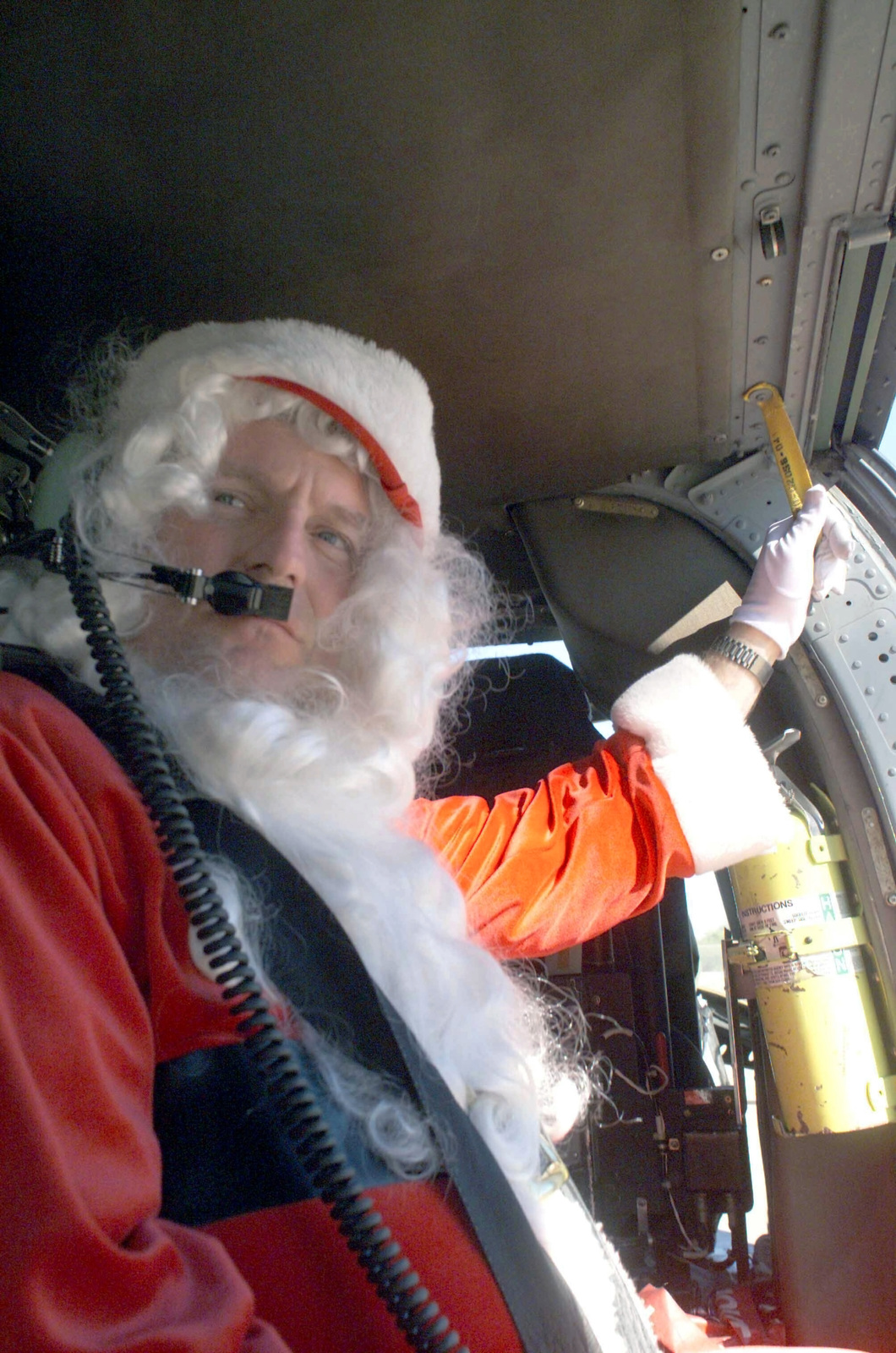 US Air Force (USAF) Colonel (COL) Paul G. Schafer, the 355th Wing Commander (WC) poses for a photograph dressed as Santa Claus aboard a US Army (USA) UH-60 Black Hawk helicopter