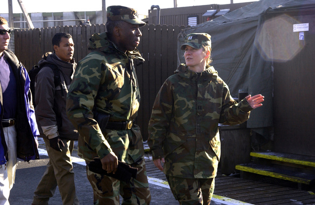 US Army (USA) Lieutenant General (LGEN) William E. Ward, Commander of Stabilization Force (COMSFOR), is greeted and briefed by Captain (CAPT) Underwood, right, a Liaison Official, on what to expect during his visit with the Russian Military Contingent Multinational Division (North) at Ugljevik, Bosnia and Herzegovina, during Operation JOINT FORGE