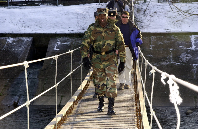 US Army (USA) Lieutenant General (LGEN) William E. Ward, Commander of Stabilization Force (COMSFOR), walks across a wood and rope bridge while meeting with troops from the Russian Military Contingent Multinational Division and observing military capabilities at Ugljevik, Bosnia and Herzegovina, in support of Operation JOINT FORGE