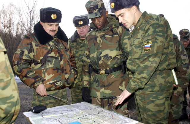 US Army (USA) Lieutenant General (LGEN) William E. Ward, second from right, Commander of Stabilization Force (COMSFOR), is briefed by members of the Russian Military Contingent Multinational Division on the areas of responsibility and military capabilities at Ugljevik, Bosnia and Herzegovina, in support of Operation JOINT FORGE