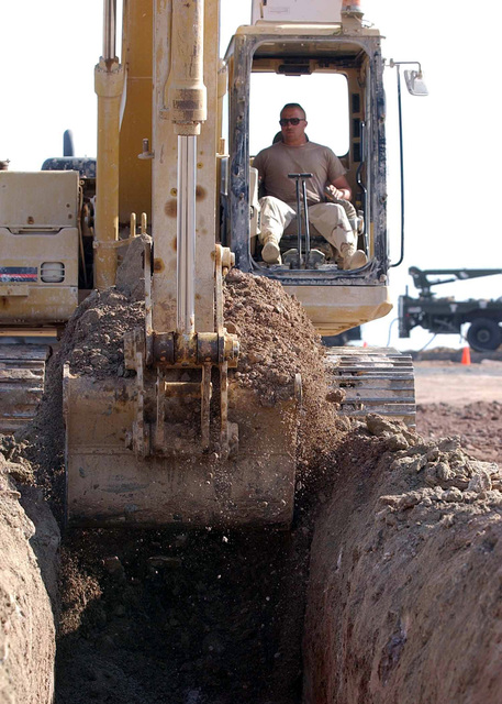 US Air Force (USAF) STAFF Sergeant (SSGT) Casey Kuhn, assigned to the 819/219th Expeditionary Horse Squadron (RHS), excavates a trench at a forward-deployed location in support of Operation ENDURING FREEDOM