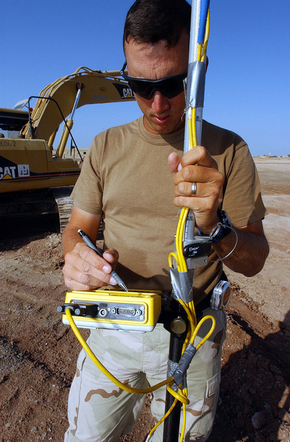 US Air Force (USAF) Technical Sergeant (TSGT) John Martin, assigned to the 819/219th Expeditionary Rapid Engineer Deployable Heavy Operational Repair Squadron Engineers (RED HORSE), checks elevations using a Global Positioning System (GPS) Receiver on a force main excavation at a forward-deployed location in support of Operation ENDURING FREEDOM. Force mains are pipelines that move wastewater under pressure to a discharge point