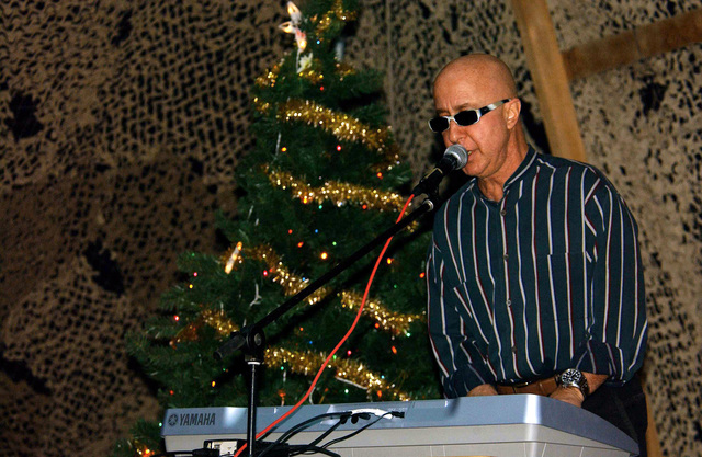 Paul Shaffer from the David Lettermen Show sings Silent Night with troops deployed with the 320th Air Expeditionary Wing (AEW) on Christmas Day at a forward-deployed location in support of Operation ENDURING FREEDOM
